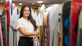 Photo of female retail worker in surf shop.